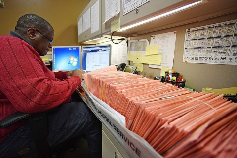 A Fulton County election worker counts provisional ballots November 7 in Atlanta. Photo: Mike Stewart/AP
