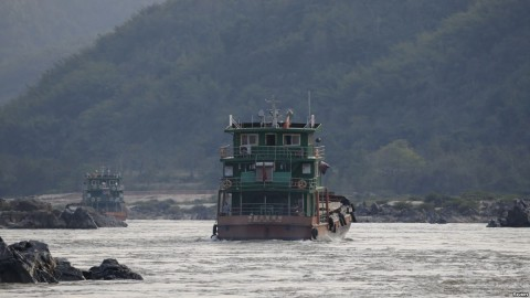 Chinese cargo ships sail on the Mekong River near the Golden Triangle at the border between Laos, Myanmar and Thailand, March 1, 2016. Photo: Reuters