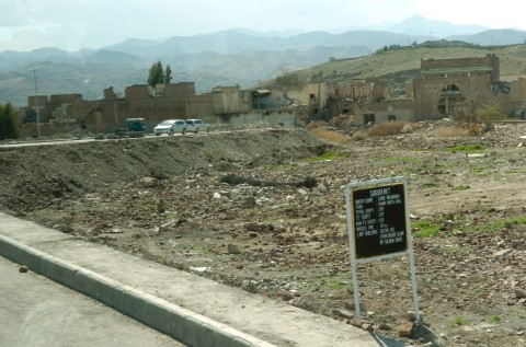 A vacant lot, leveled during the two-year Pakistani offensive against the Haqqani network lies dormant in the North Waziristan city of Miran Shah. Small placards indicate the property's ownership claims, should they return to the provincial capital. Photo: Carlo Muñoz/The Washington Times