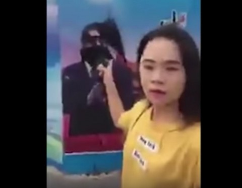 Chinese woman disappears after spraying ink on poster of Xi Jinping