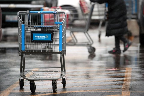 A shopping cart sits outside a Walmart store January 11, in Chicago, Illinois. Photo: Scott Olson / Getty Images